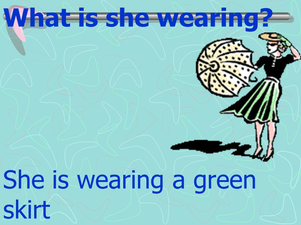 What is she wearing She is wearing a green skirt