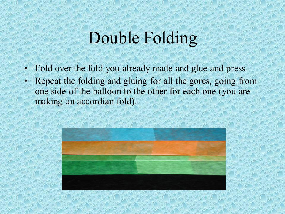 Double Folding Fold over the fold you already made and glue and press.