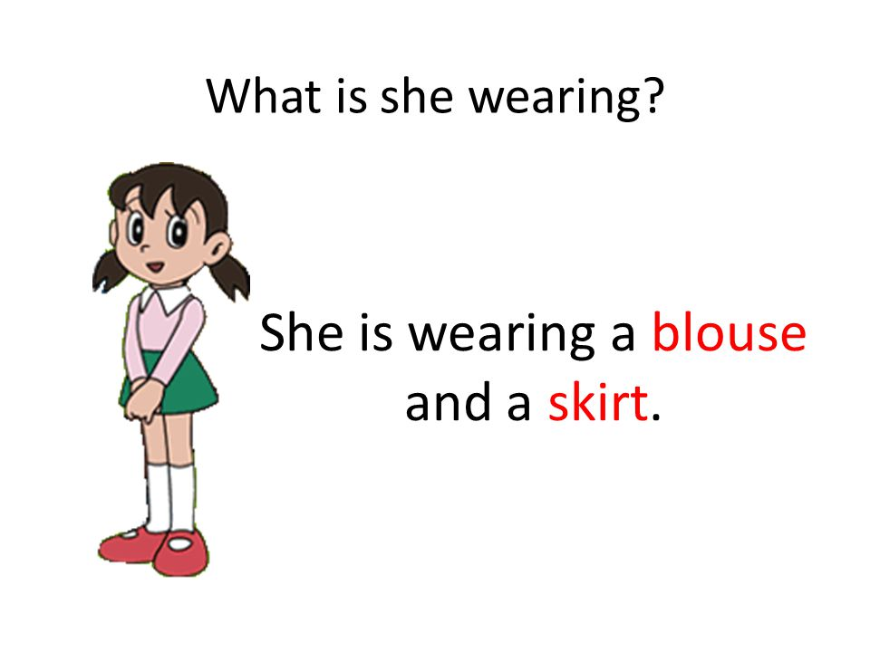 She is wearing a blouse and a skirt.