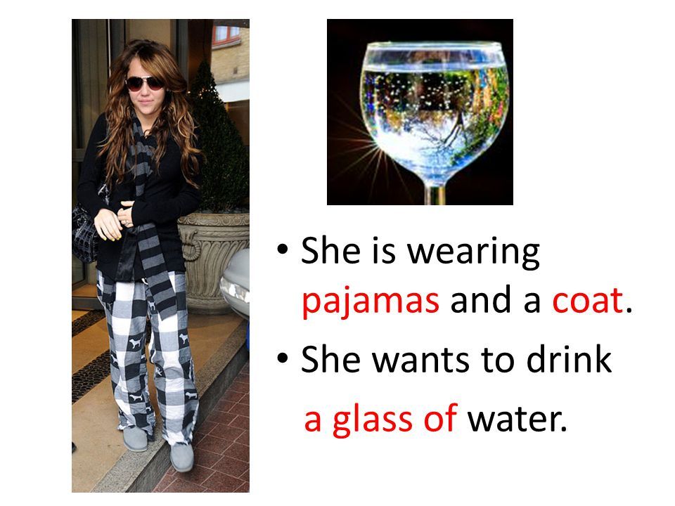 She is wearing pajamas and a coat.