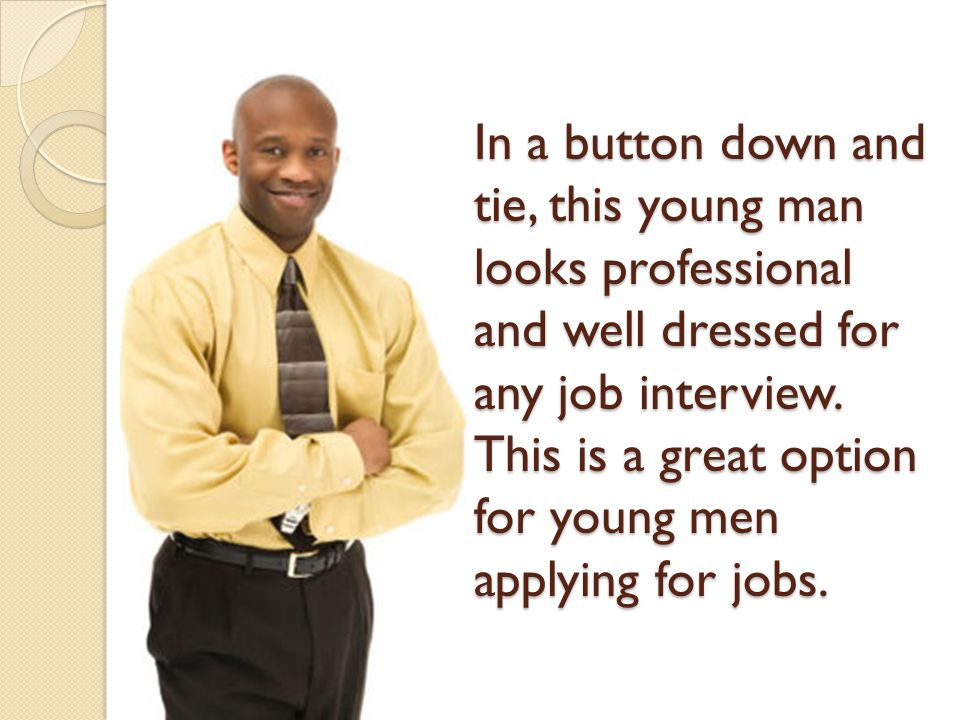In a button down and tie, this young man looks professional and well dressed for any job interview.