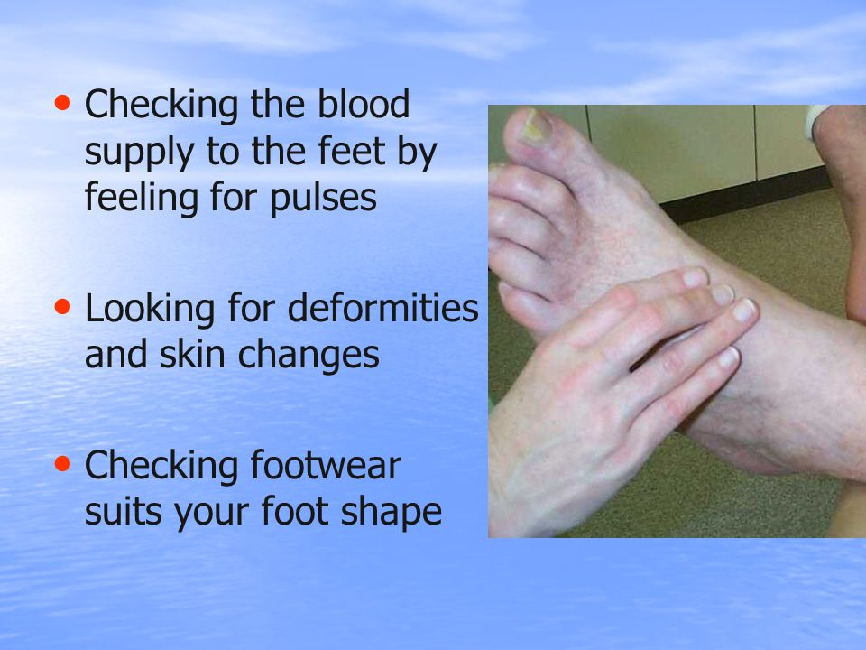 Checking the blood supply to the feet by feeling for pulses