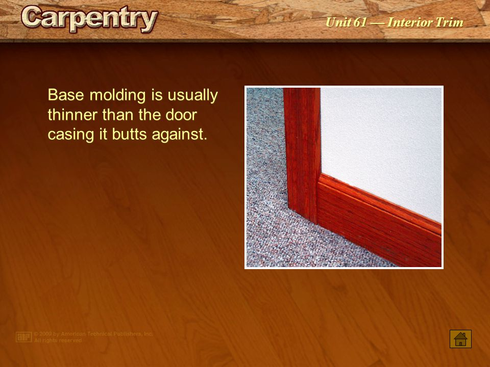 Base molding is usually thinner than the door casing it butts against.