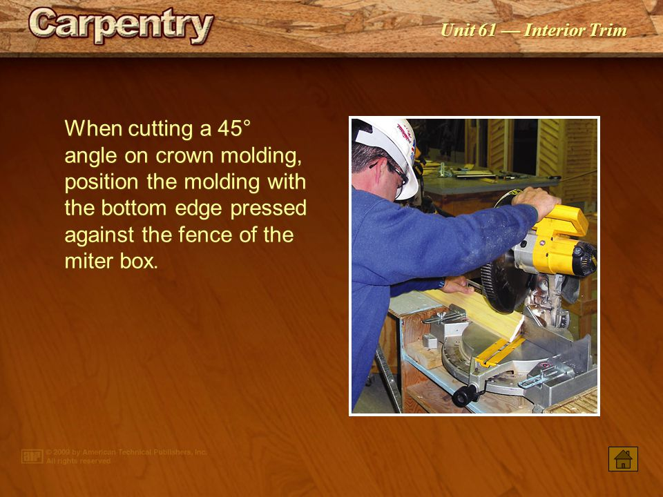 When cutting a 45° angle on crown molding, position the molding with the bottom edge pressed against the fence of the miter box.