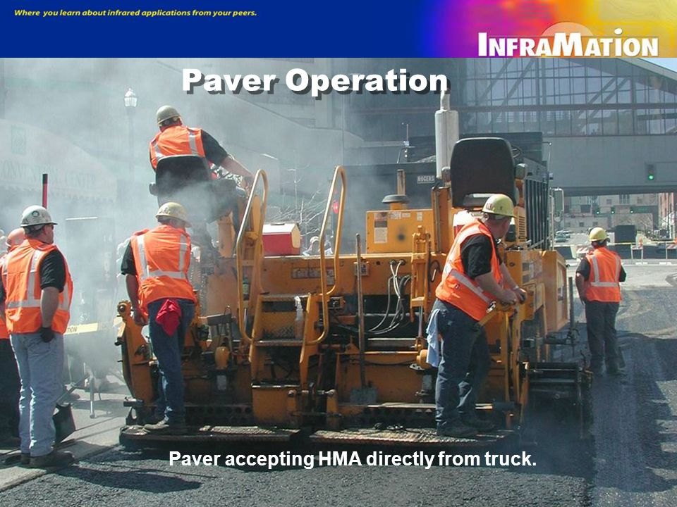 Paver Operation Paver accepting HMA directly from truck.