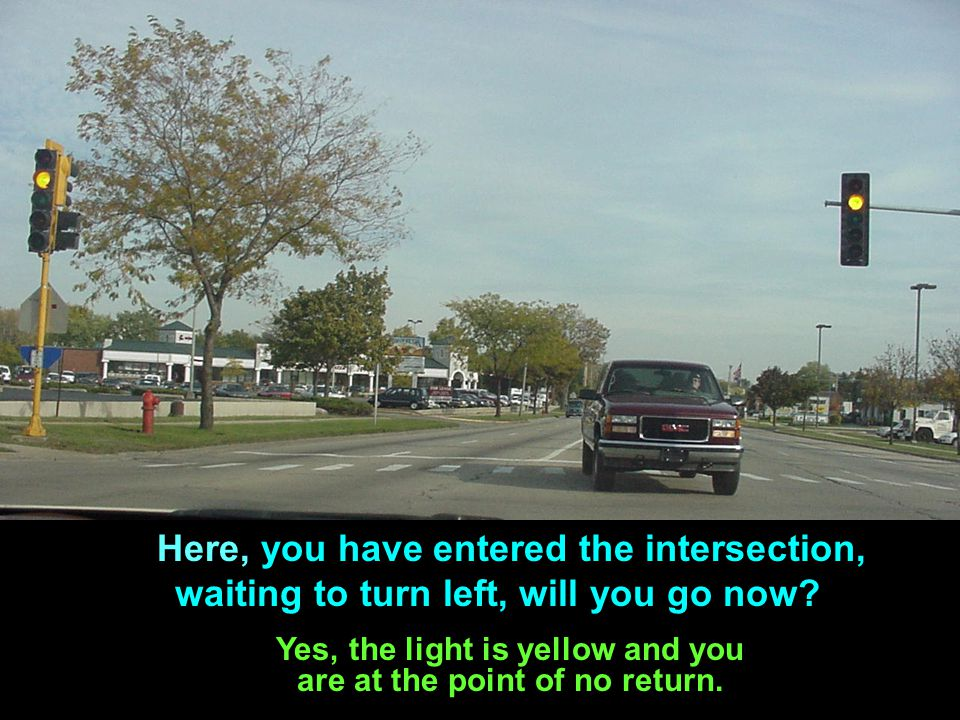 Yes, the light is yellow and you are at the point of no return.