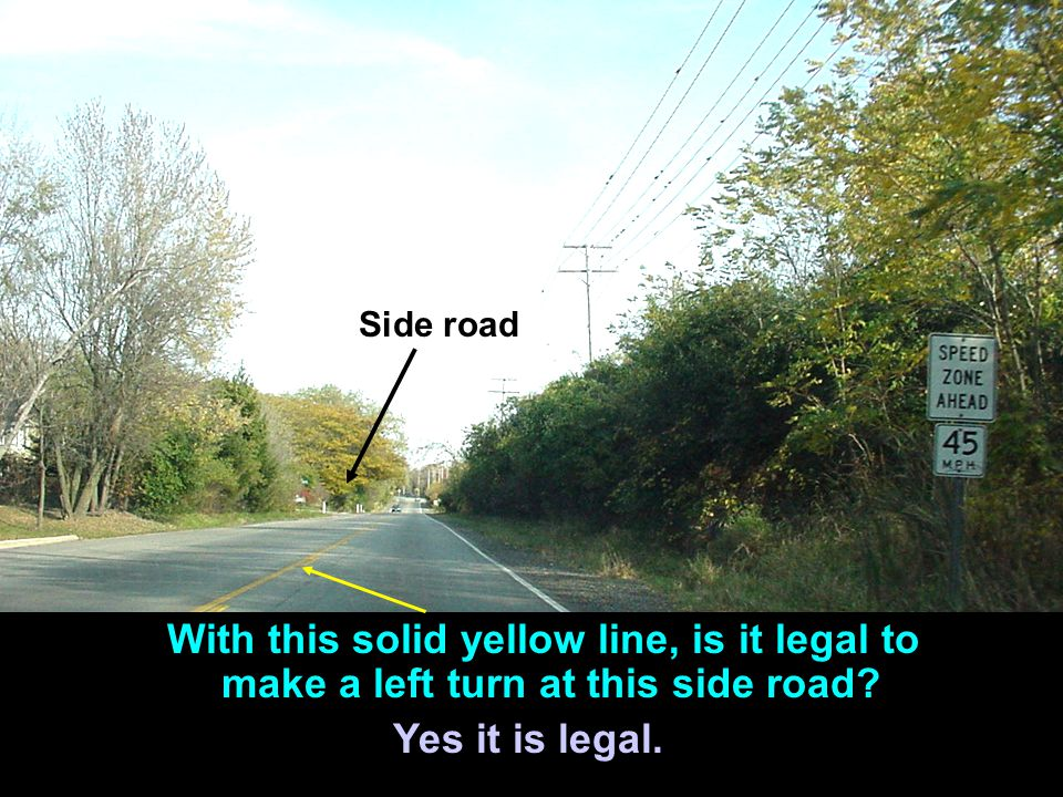Side road With this solid yellow line, is it legal to make a left turn at this side road