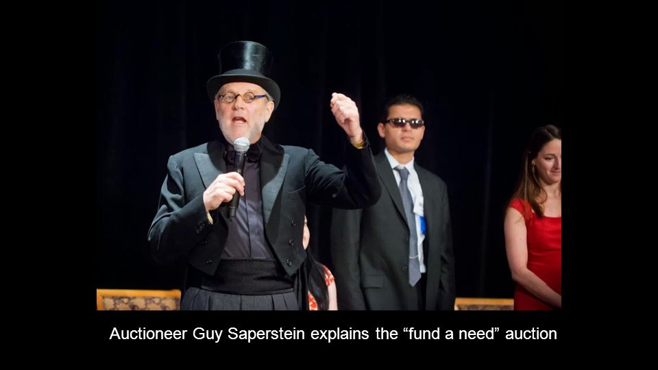 Auctioneer Guy Saperstein explains the fund a need auction