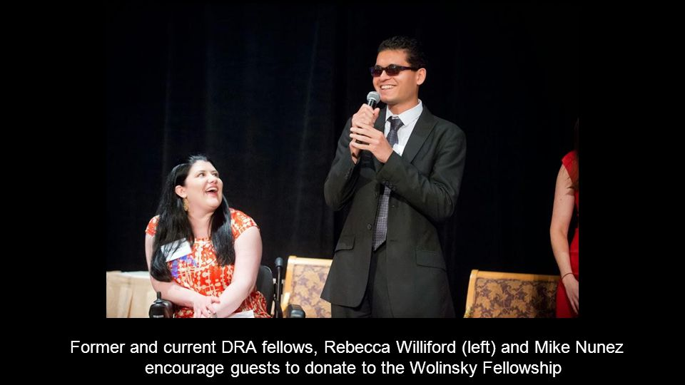 Former and current DRA fellows, Rebecca Williford (left) and Mike Nunez encourage guests to donate to the Wolinsky Fellowship