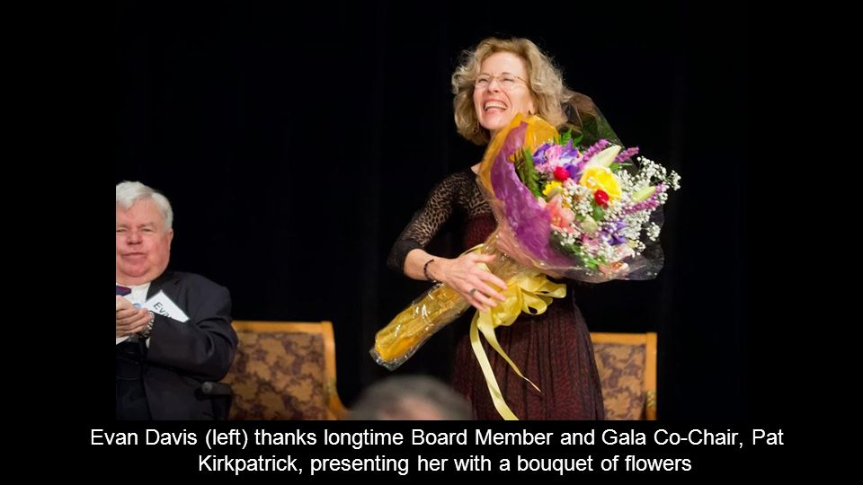 Evan Davis (left) thanks longtime Board Member and Gala Co-Chair, Pat Kirkpatrick, presenting her with a bouquet of flowers