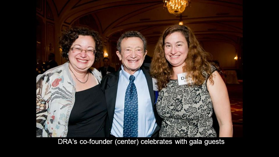 DRA's co-founder (center) celebrates with gala guests
