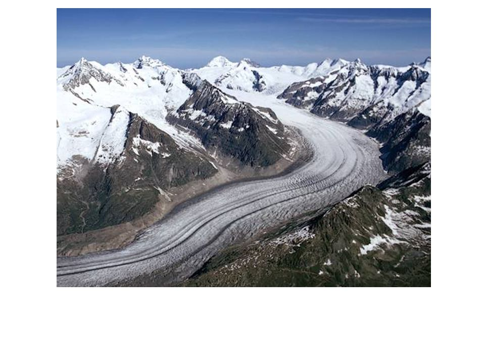 This is a picture of a glacier which carves out a U-shaped valley where it flows dragging rocks and boulders along the way.