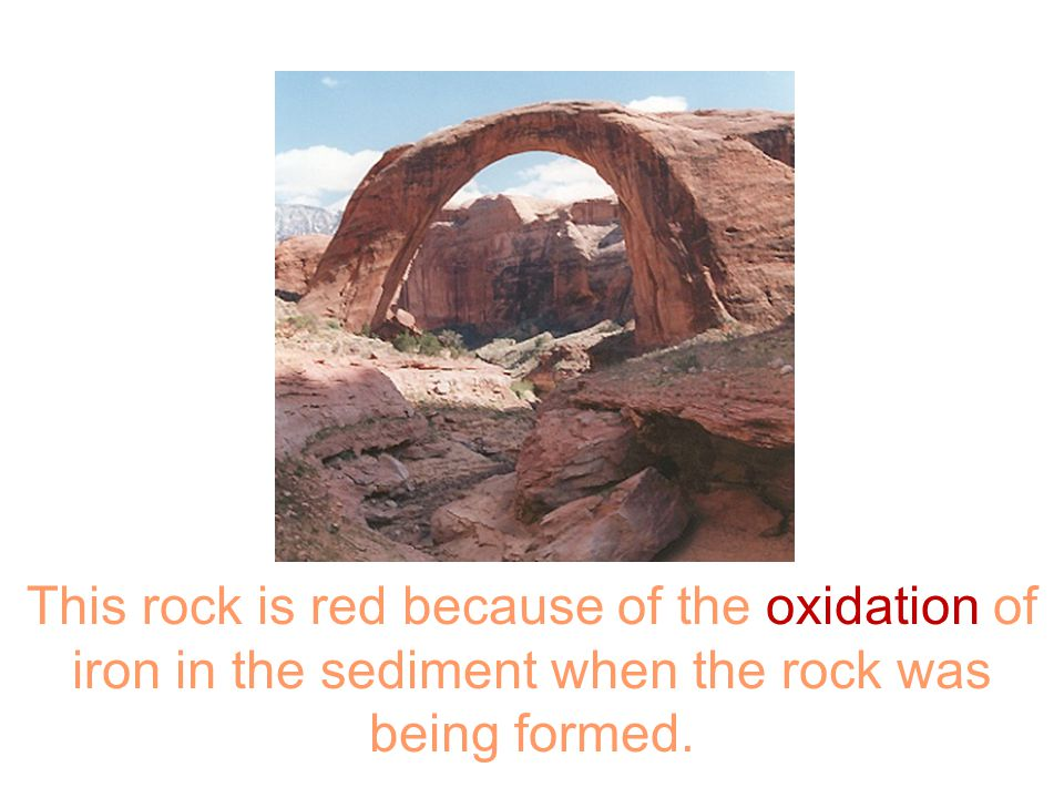 This rock is red because of the oxidation of iron in the sediment when the rock was being formed.