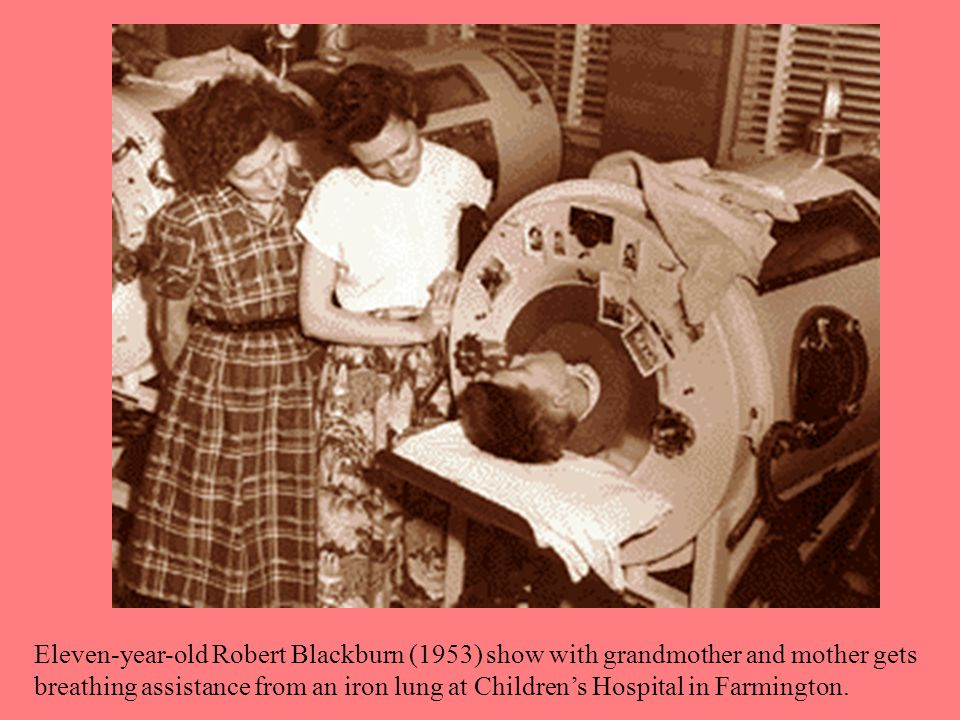 Eleven-year-old Robert Blackburn (1953) show with grandmother and mother gets breathing assistance from an iron lung at Children's Hospital in Farmington.