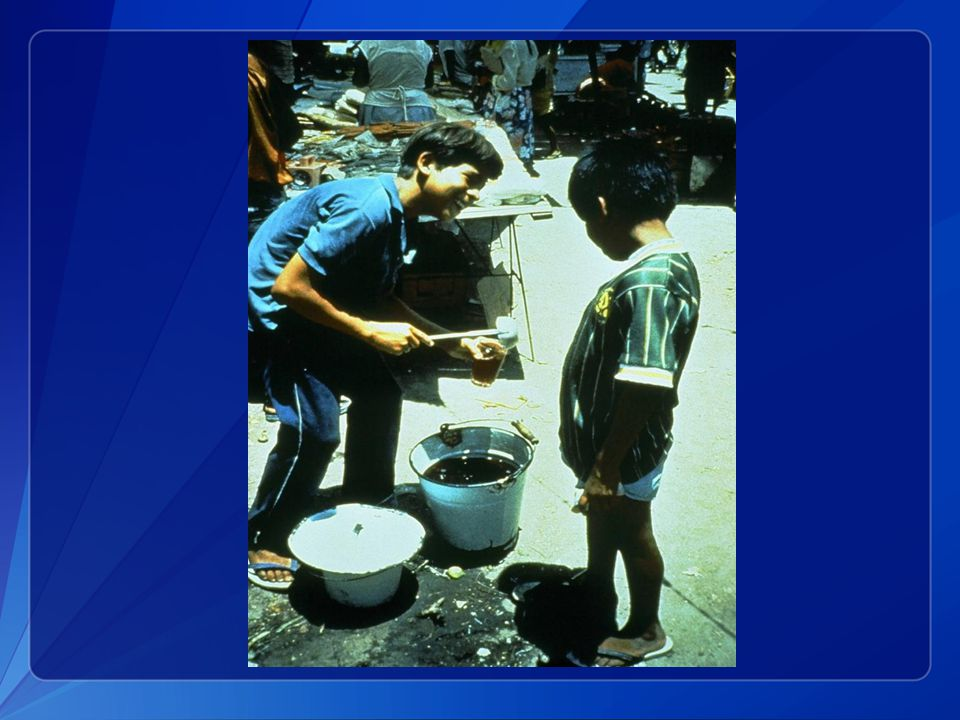 This slide from 1991 shows a Peruvian street vendor selling a corn-based drink he made at home.
