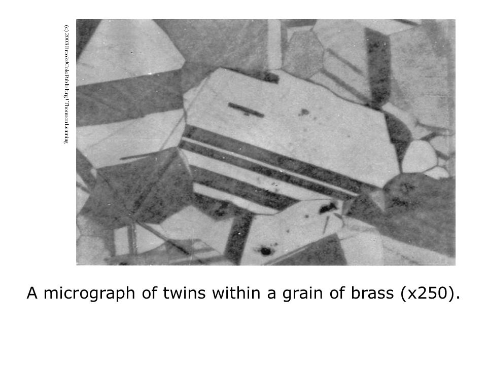 A micrograph of twins within a grain of brass (x250).