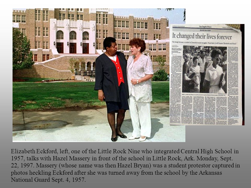 Elizabeth Eckford, left, one of the Little Rock Nine who integrated Central High School in 1957, talks with Hazel Massery in front of the school in Little Rock, Ark.