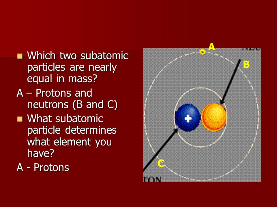 Which two subatomic particles are nearly equal in mass