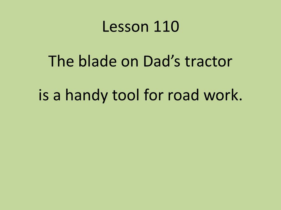 The blade on Dad's tractor is a handy tool for road work.