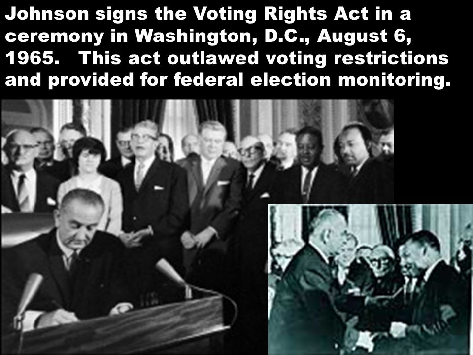 Johnson signs the Voting Rights Act in a ceremony in Washington, D. C