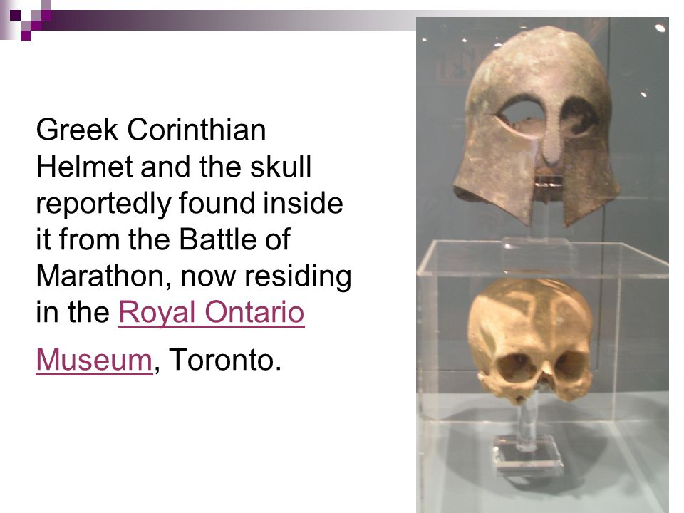 Greek Corinthian Helmet and the skull reportedly found inside it from the Battle of Marathon, now residing in the Royal Ontario Museum, Toronto.