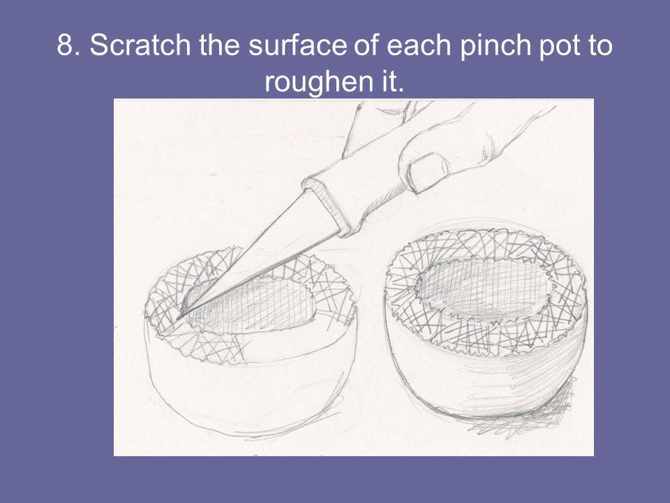8. Scratch the surface of each pinch pot to roughen it.