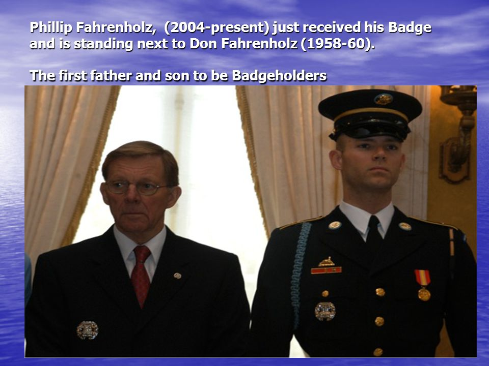 Phillip Fahrenholz, (2004-present) just received his Badge and is standing next to Don Fahrenholz (1958-60).