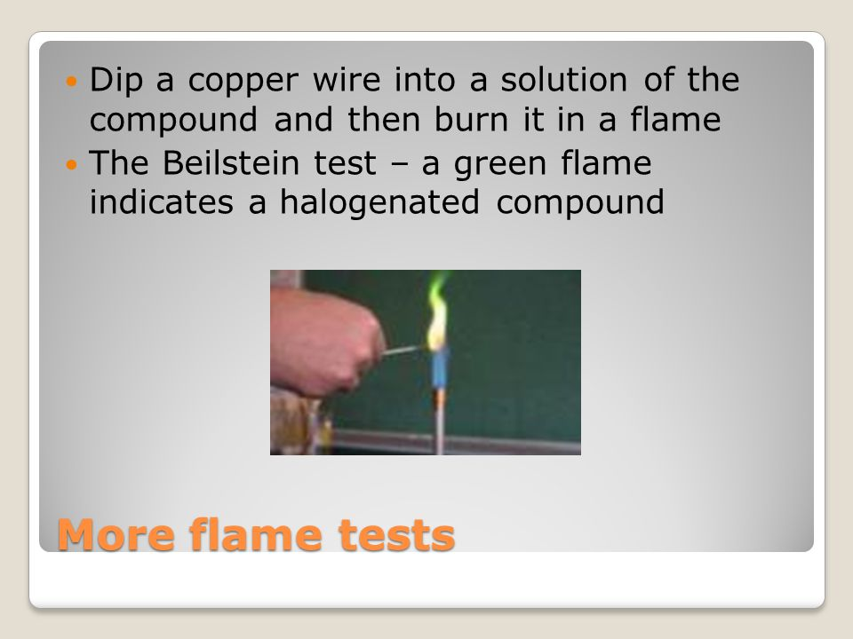Dip a copper wire into a solution of the compound and then burn it in a flame