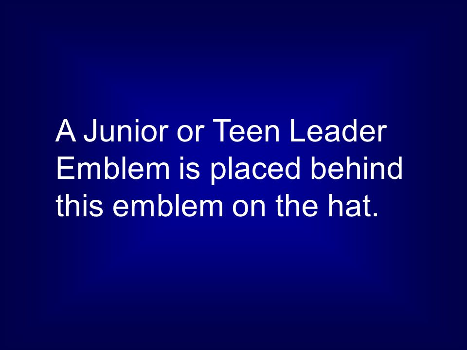 A Junior or Teen Leader Emblem is placed behind this emblem on the hat.