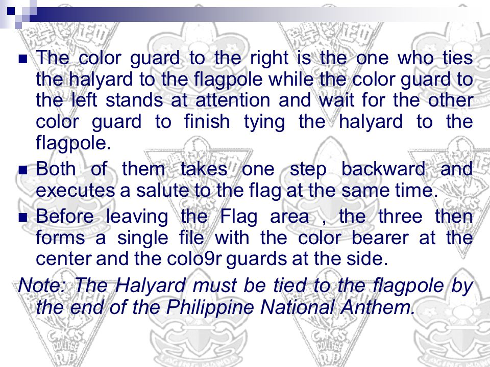 The color guard to the right is the one who ties the halyard to the flagpole while the color guard to the left stands at attention and wait for the other color guard to finish tying the halyard to the flagpole.