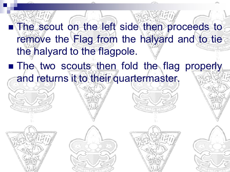 The scout on the left side then proceeds to remove the Flag from the halyard and to tie the halyard to the flagpole.