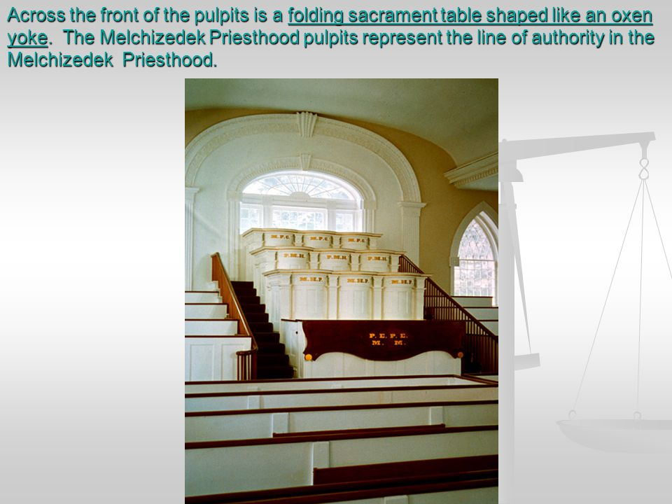 Across the front of the pulpits is a folding sacrament table shaped like an oxen yoke.