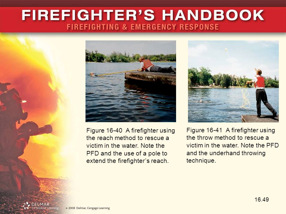 Figure 16-40 A firefighter using the reach method to rescue a victim in the water. Note the PFD and the use of a pole to extend the firefighter's reach.