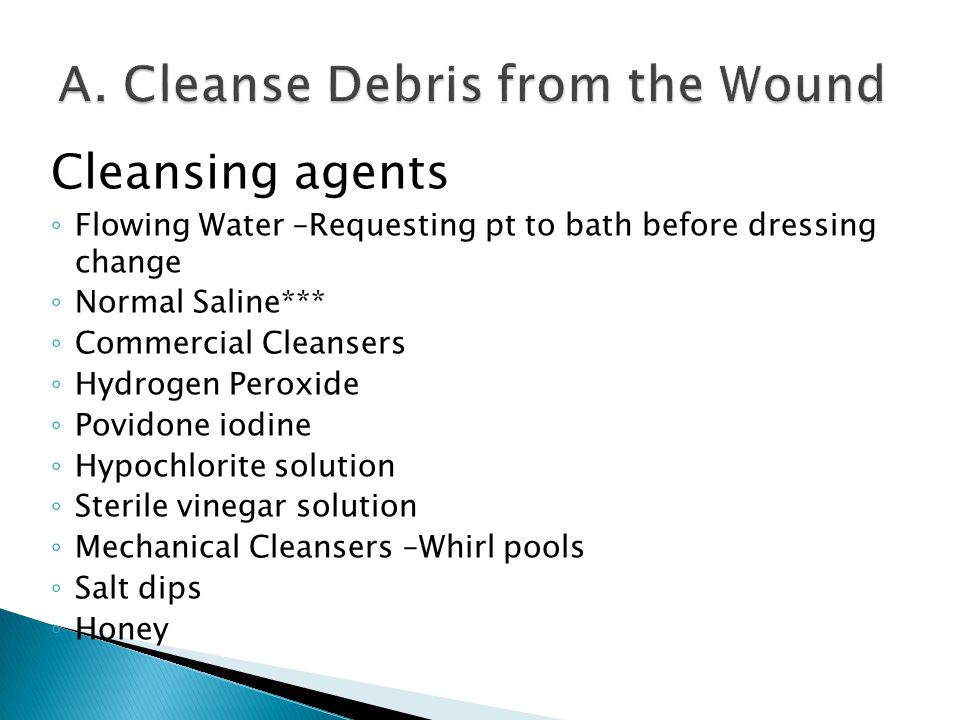A. Cleanse Debris from the Wound