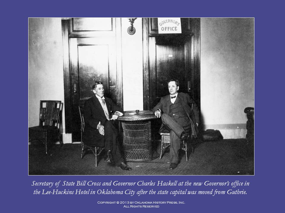 Secretary of State Bill Cross and Governor Charles Haskell at the new Governor's office in the Lee-Huckins Hotel in Oklahoma City after the state capital was moved from Guthrie.