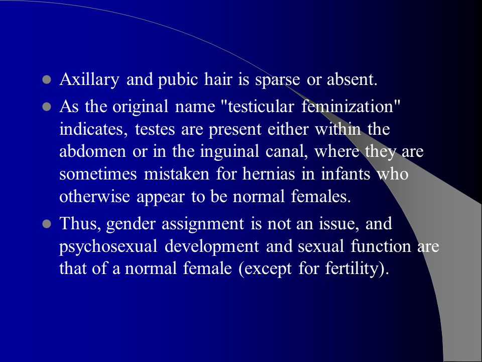 Axillary and pubic hair is sparse or absent.