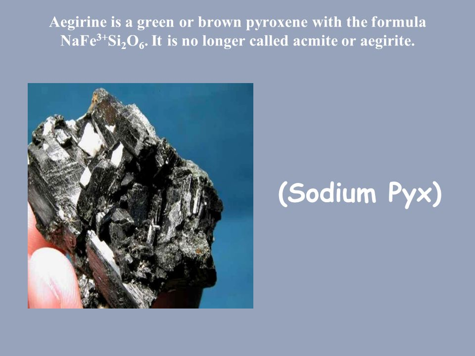 Aegirine is a green or brown pyroxene with the formula NaFe3+Si2O6