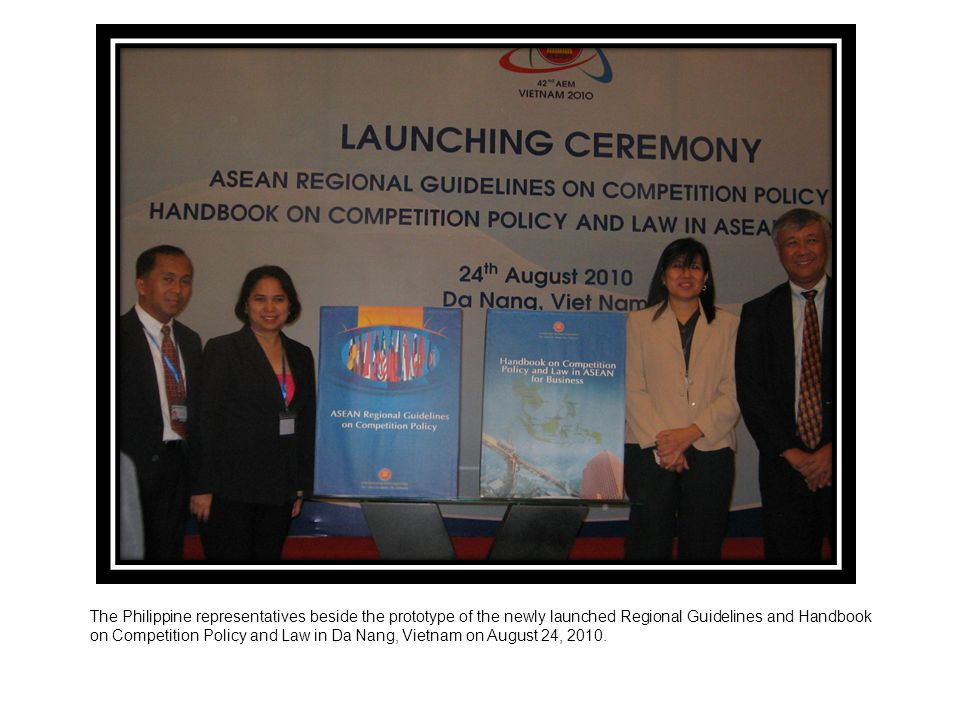 The Philippine representatives beside the prototype of the newly launched Regional Guidelines and Handbook on Competition Policy and Law in Da Nang, Vietnam on August 24, 2010.