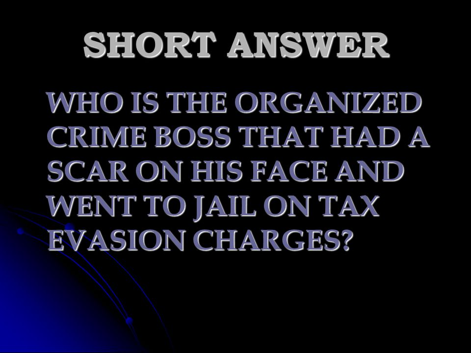 SHORT ANSWER WHO IS THE ORGANIZED CRIME BOSS THAT HAD A SCAR ON HIS FACE AND WENT TO JAIL ON TAX EVASION CHARGES