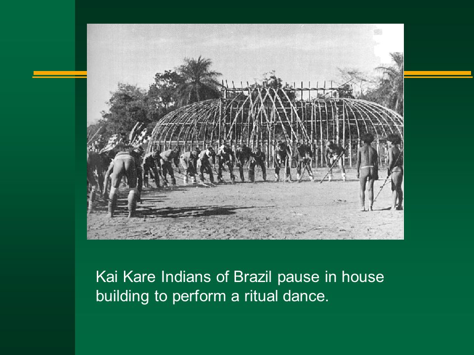 Kai Kare Indians of Brazil pause in house building to perform a ritual dance.
