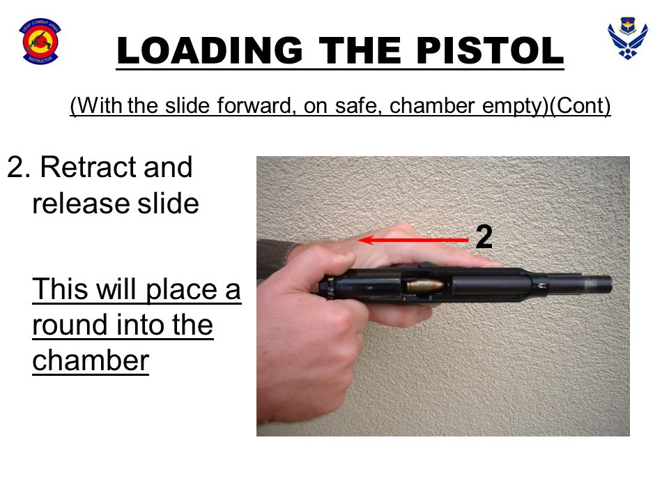 LOADING THE PISTOL (With the slide forward, on safe, chamber empty)(Cont)