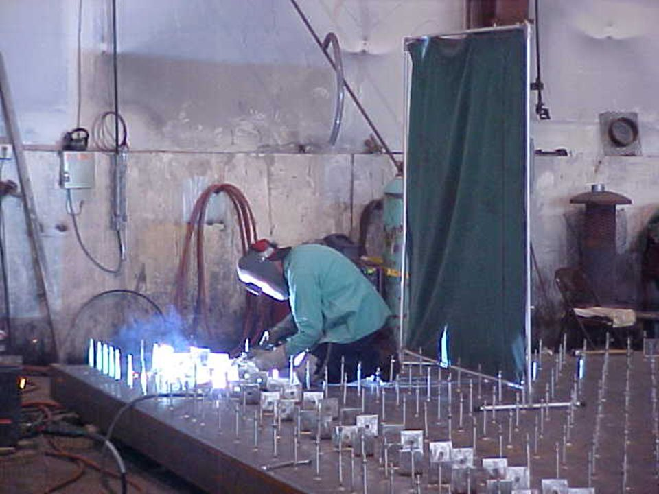 Welding curtain to contain sparks and slag away from other operations.