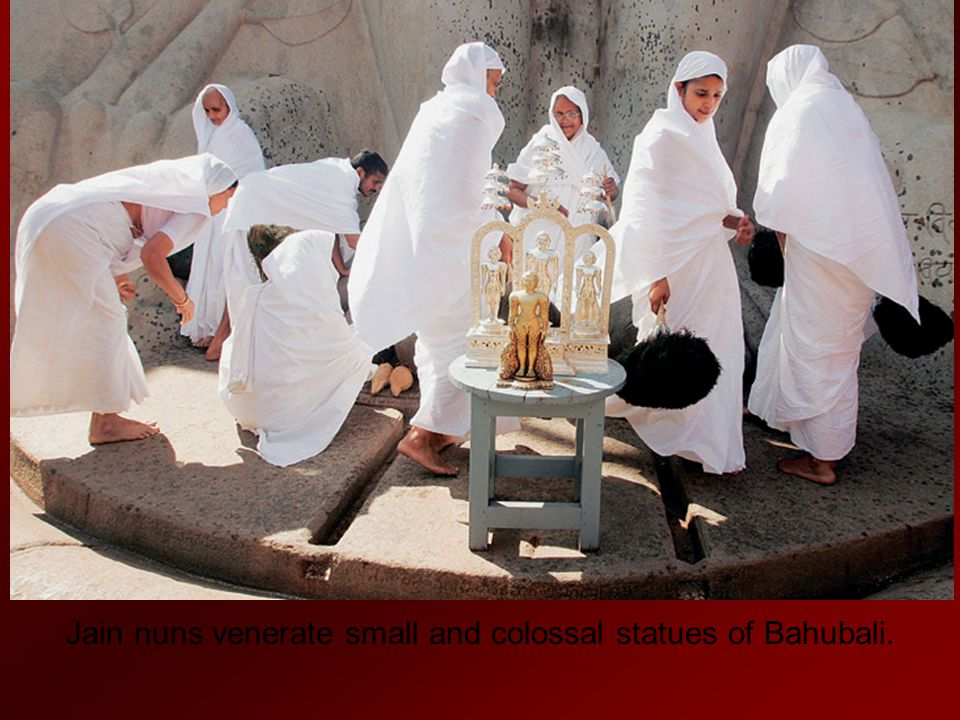 Jain nuns venerate small and colossal statues of Bahubali.
