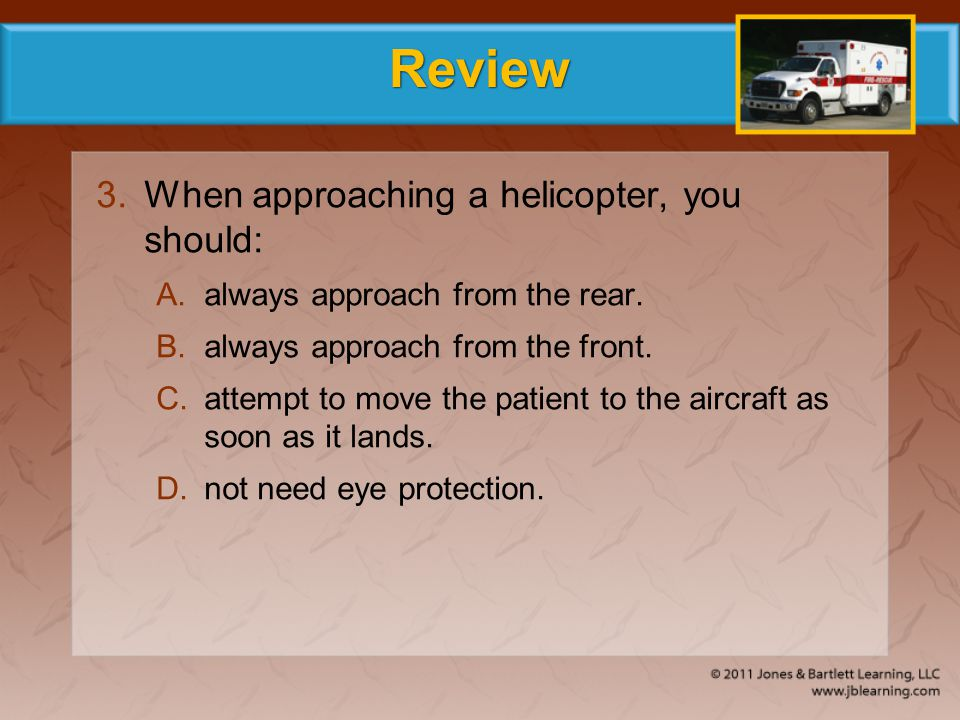 Review When approaching a helicopter, you should: