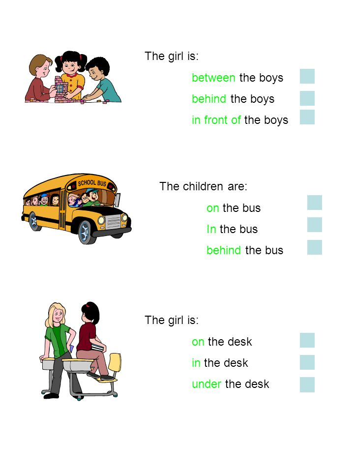 The girl is: between the boys. behind the boys. in front of the boys. The children are: on the bus.