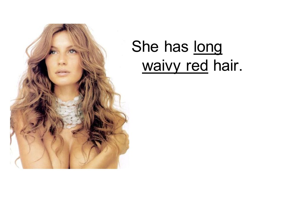 She has long waivy red hair.