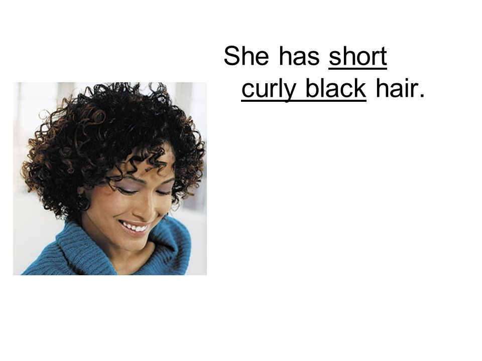 She has short curly black hair.