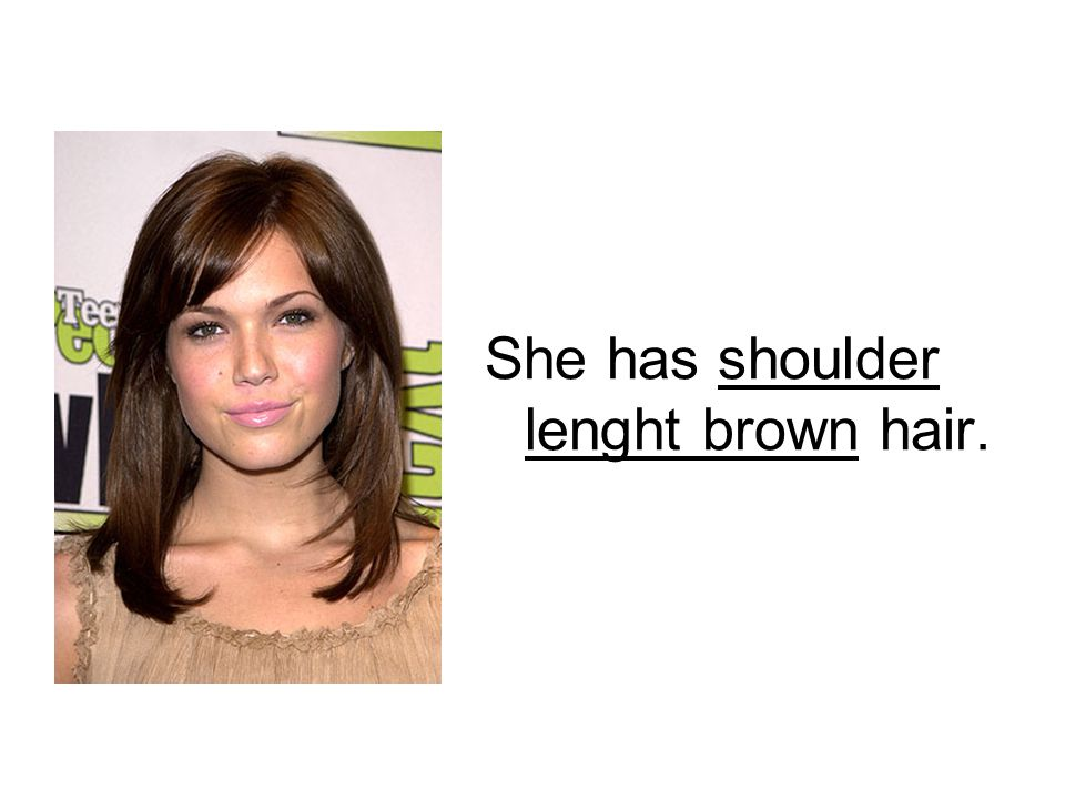She has shoulder lenght brown hair.