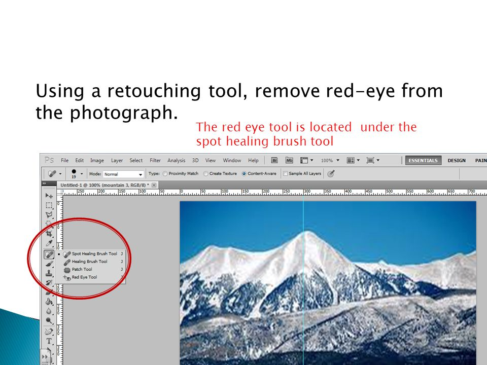 Using a retouching tool, remove red-eye from the photograph.