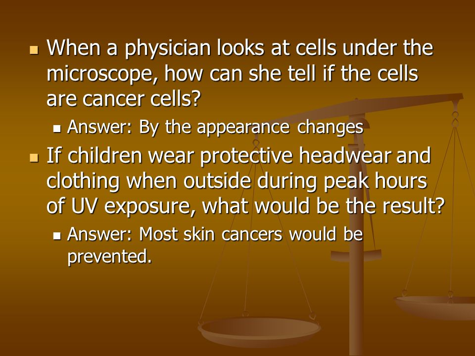 When a physician looks at cells under the microscope, how can she tell if the cells are cancer cells